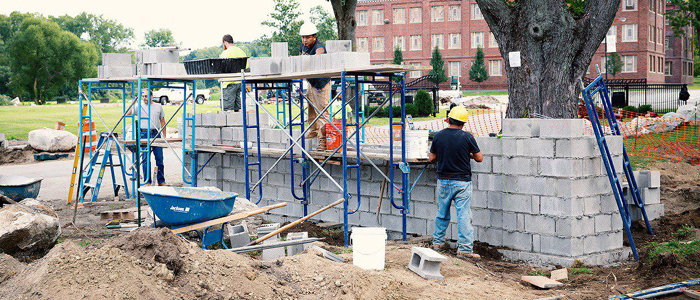 Concrete Blocks Being Built by Masons